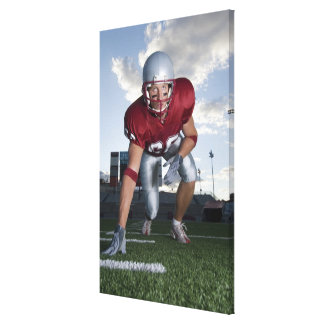 Football player in game stance canvas print