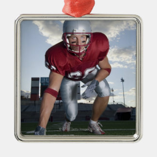 Football player in game stance christmas ornament