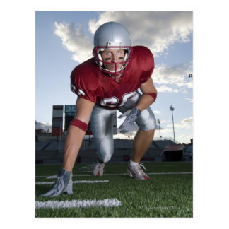 Football player in game stance postcard