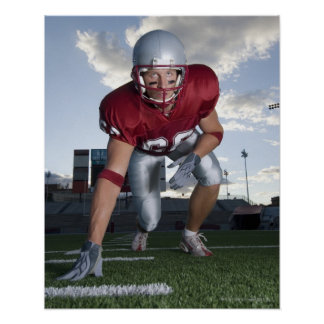 Football player in game stance poster