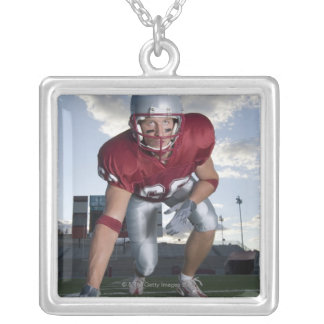 Football player in game stance silver plated necklace