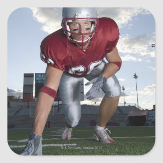 Football player in game stance square sticker