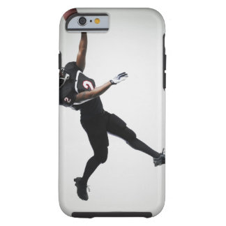 Football player leaping in mid air to catch ball tough iPhone 6 case