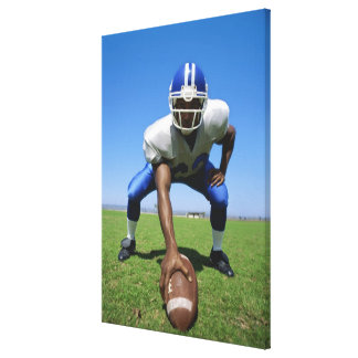 football player playing on a football field canvas print