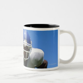 football player playing on a football field coffee mug