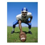 football player playing on a football field postcards