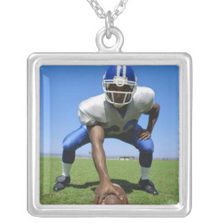 football player playing on a football field square pendant necklace