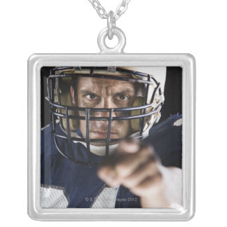 Football player pointing and looking intense personalized necklace