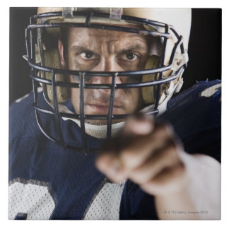 Football player pointing and looking intense tile