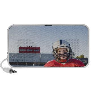 Football player posing on field travelling speaker