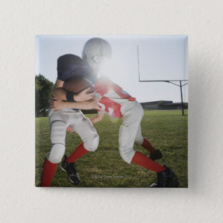 Football player tackling opponent 15 cm square badge