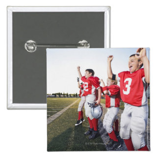 Football players cheering on sideline 15 cm square badge