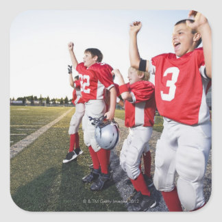Football players cheering on sideline square sticker