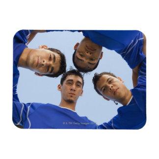 Football players huddled together rectangular photo magnet