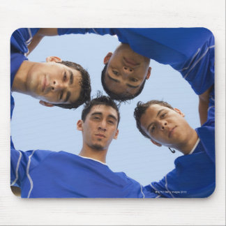 Football players huddled together mouse mat
