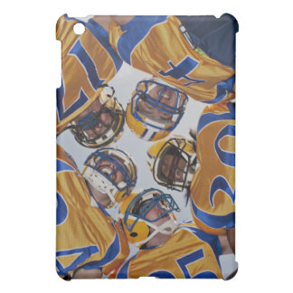 Football players in huddle cover for the iPad mini