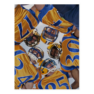 Football players in huddle postcard