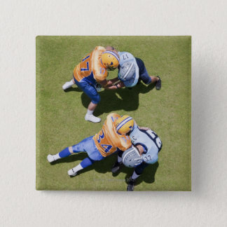 Football players playing football 2 15 cm square badge