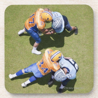 Football players playing football 2 coaster