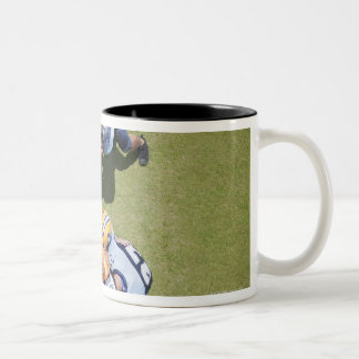 Football players playing football 2 coffee mug
