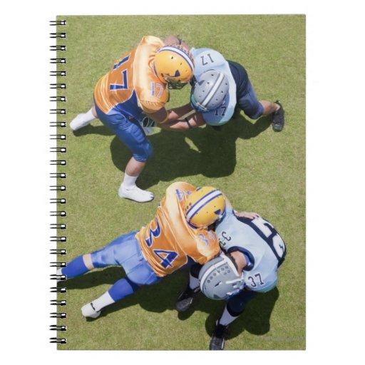 Football players playing football 2 notebook