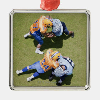 Football players playing football 2 Silver-Colored square decoration