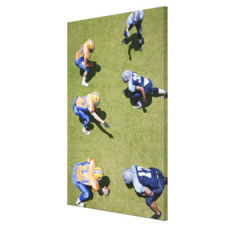 Football players playing football canvas print