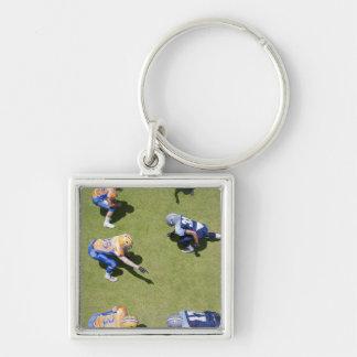 Football players playing football key ring