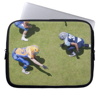 Football players playing football laptop sleeve