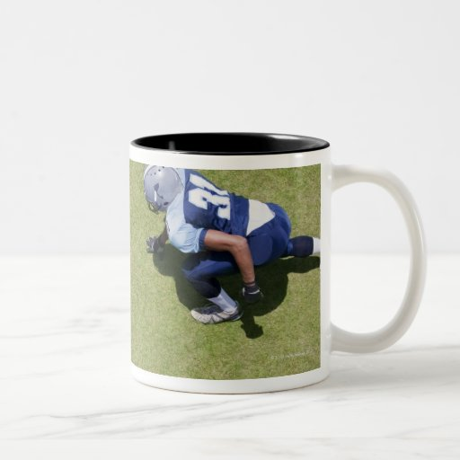 Football players playing football coffee mug