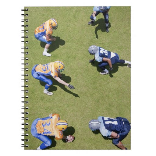 Football players playing football note books