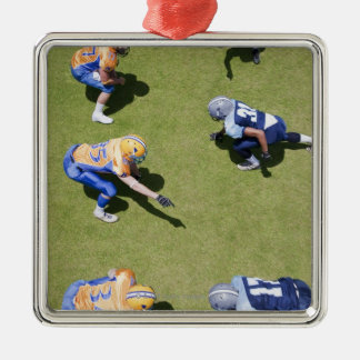 Football players playing football Silver-Colored square decoration