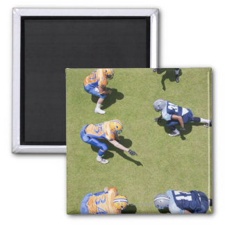 Football players playing football square magnet