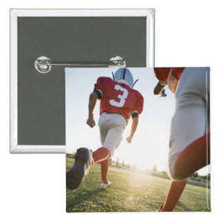 Football players running on field 15 cm square badge