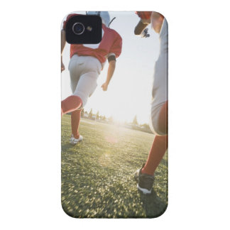 Football players running on field Case-Mate iPhone 4 cases
