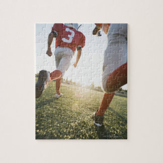 Football players running on field jigsaw puzzle