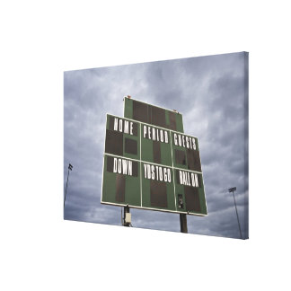Football scoreboard and storm clouds. canvas print