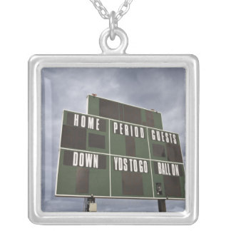 Football scoreboard and storm clouds. silver plated necklace