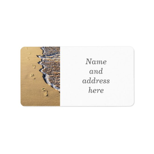 Footprints in sand on beach label