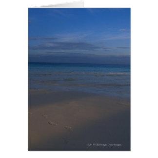Footprints on beach card