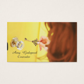 Foppery of the girl the key hole of the door is business card