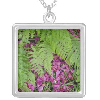 Forest ferns with pink flower petals on ground silver plated necklace