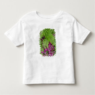 Forest ferns with pink flower petals on ground toddler T-Shirt
