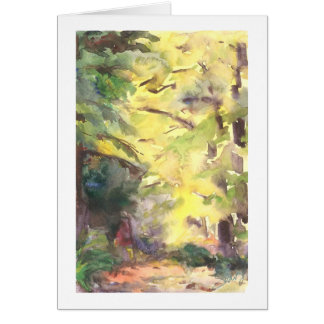 Forest path highlighted by sun greeting card
