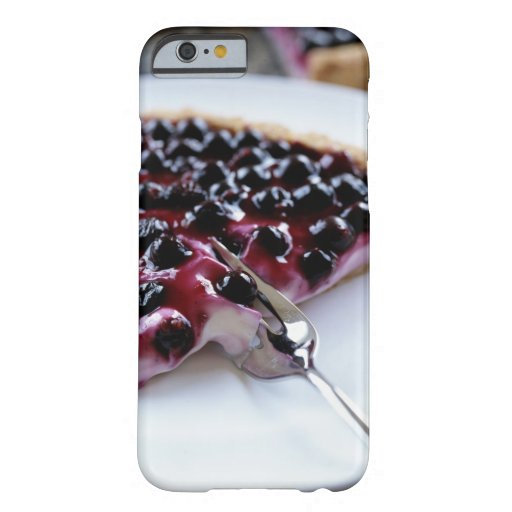 Fork slicing blueberry pie on plate iPhone 6 case
