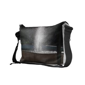 Fountain in cagliari courier bag