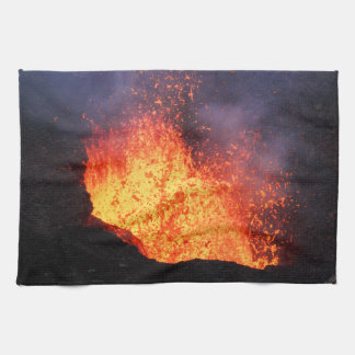 Fountain of hot lava eruption from volcano crater kitchen towel