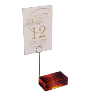 Fountain of lava erupts from crater of volcano place card holder