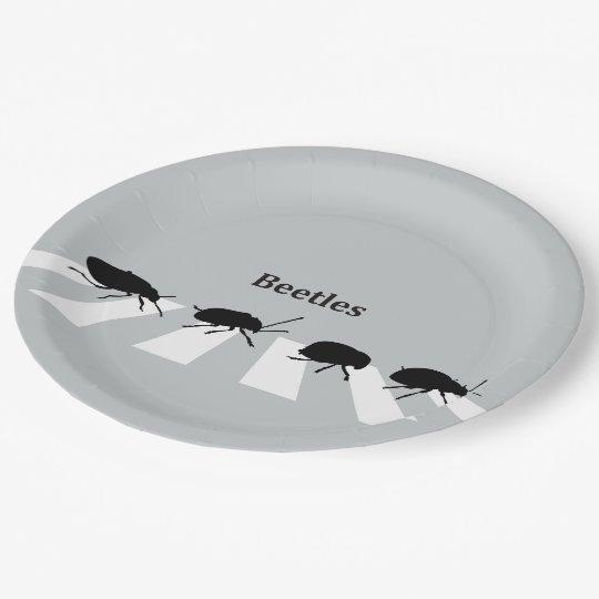 Four beetles walking across a crosswalk in London… Paper Plate