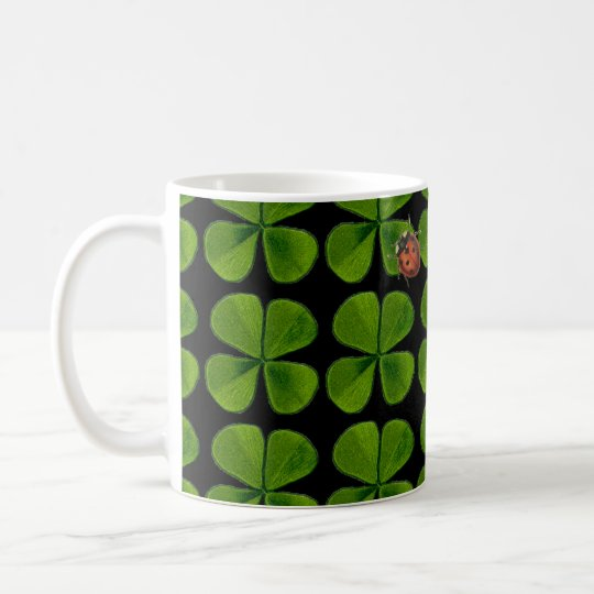 Four-leaf clovers and ladybug - black background coffee